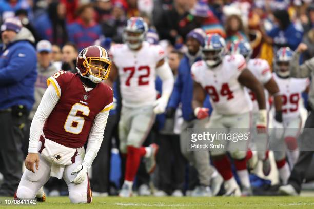 Quarterback Mark Sanchez of the Washington Redskins reacts after an interception in the second quarter against the New York Giants at FedExField on...