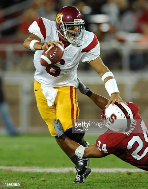 USC quarterback Mark Sanchez tries to elude tackle of Trevor Hooper of Stanford in the fourth quarter of 420 victory over Stanford in Pacific10...