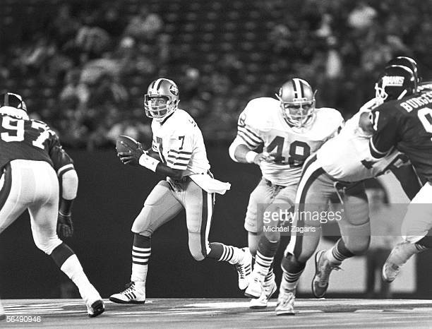 Quarterback Mark Stevens of the San Francisco 49ers looks for an open receiver during the game against the New York Giants on October 5 1987 at...