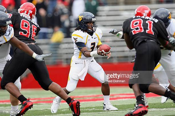 Quarterback Markell Harrison of the West Virginia Mountaineers hands off the ball against the Rutgers University Scarlett Knights on October 27, 2007...