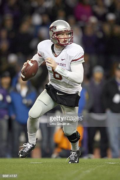 Quarterback Marshall Lobbestael of the Washington State Cougars runs to pass the ball during the game against the Washington Huskies on November 28,...