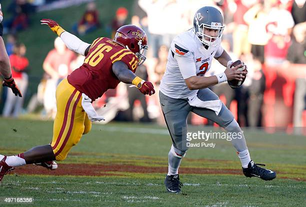 Quarterback Mason Rudolph of the Oklahoma State Cowboys breaks away from linebacker Willie Harvey of the Iowa State Cyclones as he scrambles for...