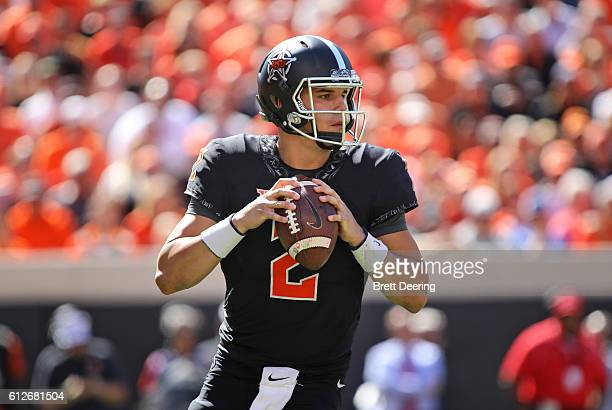 Quarterback Mason Rudolph of the Oklahoma State Cowboys looks to throw against the Texas Longhorns October 1 2016 at Boone Pickens Stadium in...