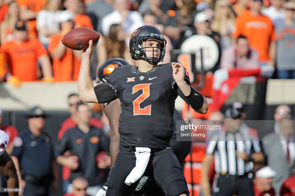 Quarterback Mason Rudolph #2 of the Oklahoma State Cowboys looks to throw against the Oklahoma Sooners at Boone Pickens Stadium on November 4, 2017 in Stillwater, Oklahoma. Oklahoma defeated Oklahoma State 62-52.