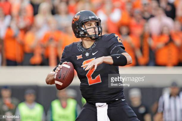 Quarterback Mason Rudolph of the Oklahoma State Cowboys looks to throw against the Oklahoma Sooners at Boone Pickens Stadium on November 4 2017 in...