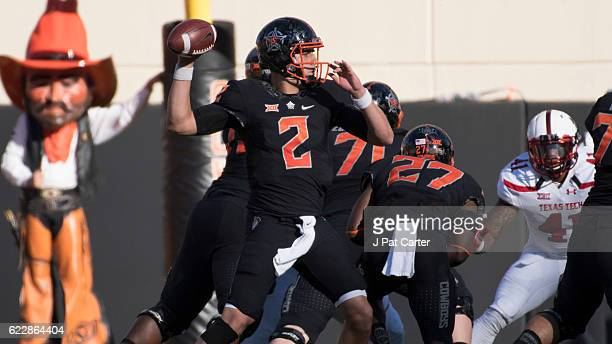 Quarterback Mason Rudolph of the Oklahoma State Cowboys runs a pass play against Texas Tech Red Raiders during the first half of a NCAA football game...