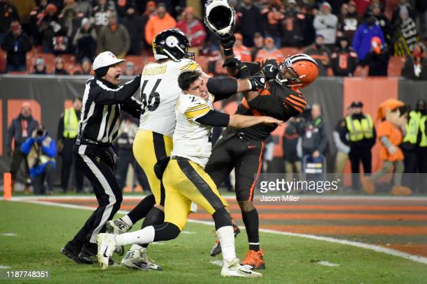 Quarterback Mason Rudolph of the Pittsburgh Steelers fights with defensive end Myles Garrett of the Cleveland Browns during the second half at...