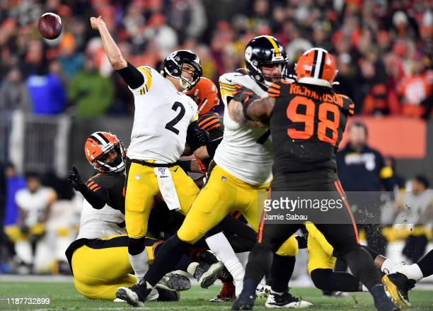 Quarterback Mason Rudolph of the Pittsburgh Steelers is tackled by the defense of the Pittsburgh Steelers during the game at FirstEnergy Stadium on...