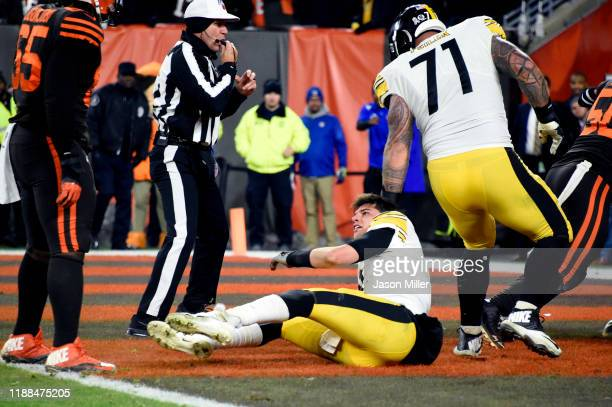 Quarterback Mason Rudolph of the Pittsburgh Steelers sits on the field after fighting with defensive end Myles Garrett of the Cleveland Browns during...