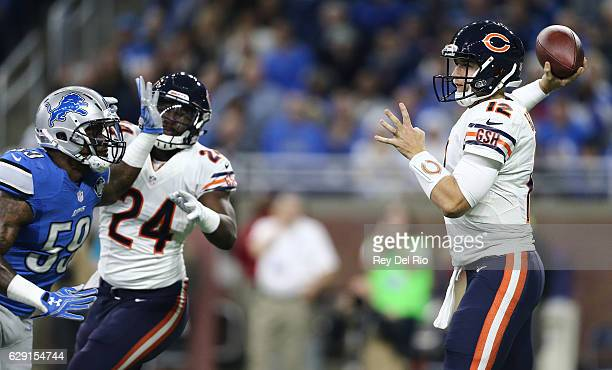 Quarterback Matt Barkley of the Chicago Bears looks to pass the ball against Tahir Whitehead of the Detroit Lions as Jordan Howard of the Chicago...