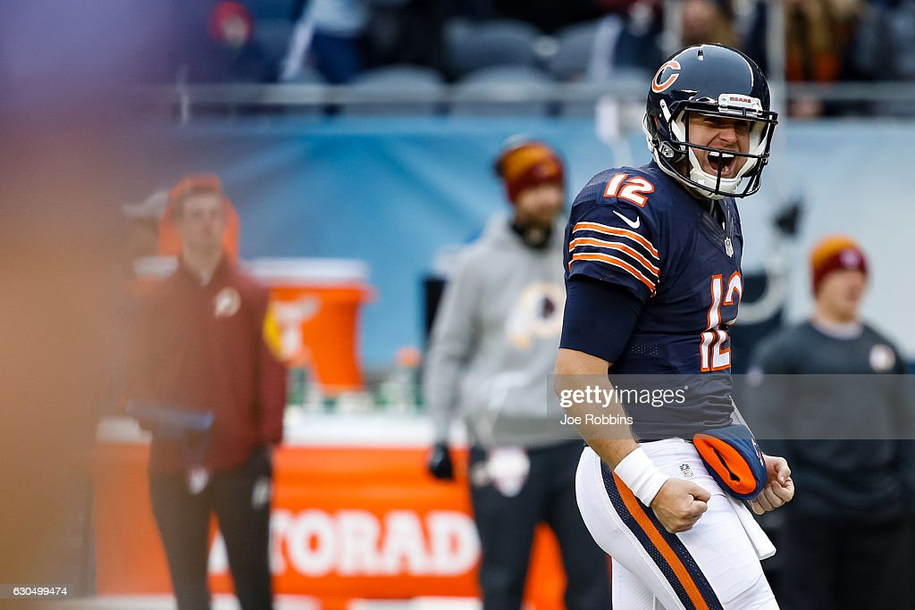 Quarterback Matt Barkley #12 of the Chicago Bears reacts after throwing a 21 yd. pass completed by Cameron Meredith #81 (not pictured) for a touchdown in the second quarter against the Washington Redskins at Soldier Field on December 24, 2016 in Chicago, Illinois.