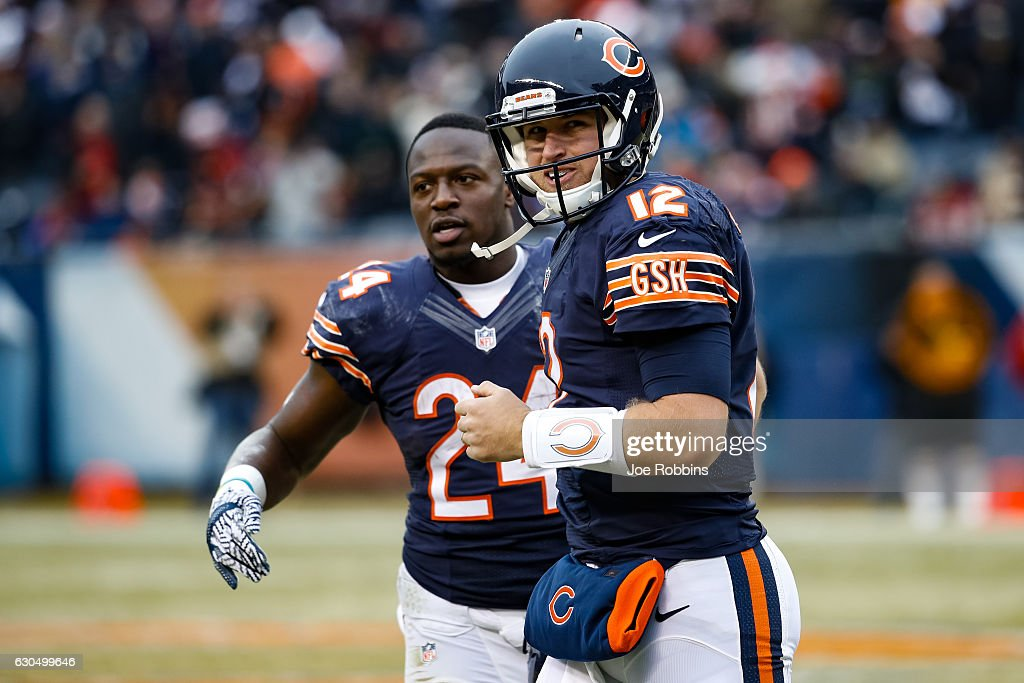 Quarterback Matt Barkley #12 of the Chicago Bears reacts next to Jordan Howard #24 after throwing a 21 yd. pass completed by Cameron Meredith #81 (not pictured) for a touchdown in the second quarter against the Washington Redskins at Soldier Field on December 24, 2016 in Chicago, Illinois.