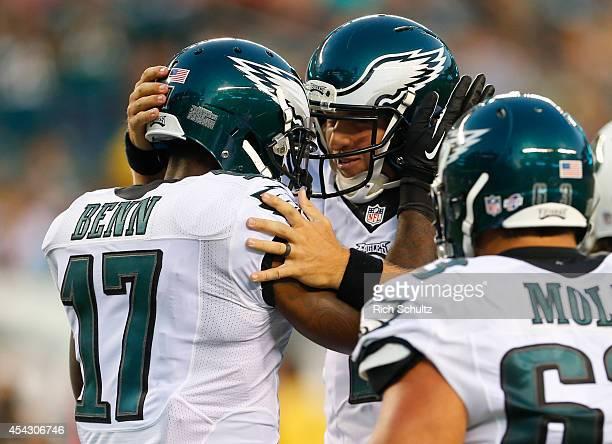 Quarterback Matt Barkley of the Philadelphia Eagles reacts with wide receiver Arrelious Benn after Benn caught a touchdown pass in the preseason game...