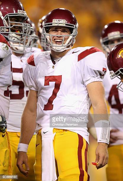 Quarterback Matt Barkley of the USC Trojans smiles while standing in the huddle during the college football game against the Arizona State Sun Devils...