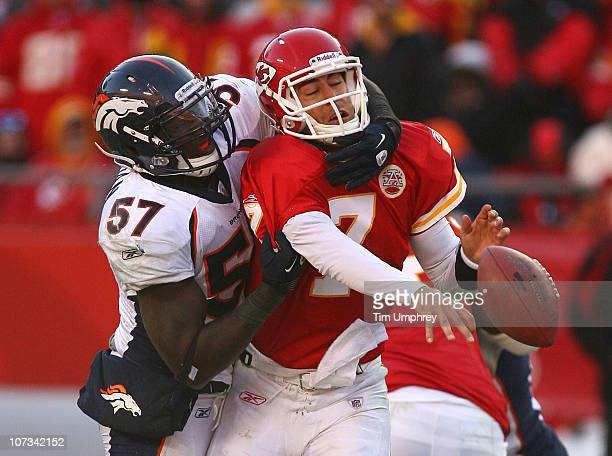 Quarterback Matt Cassel of the Kansas City Chiefs is hit as he throws by linebacker Mario Haggan of the Denver Broncos in a game at Arrowhead Stadium...