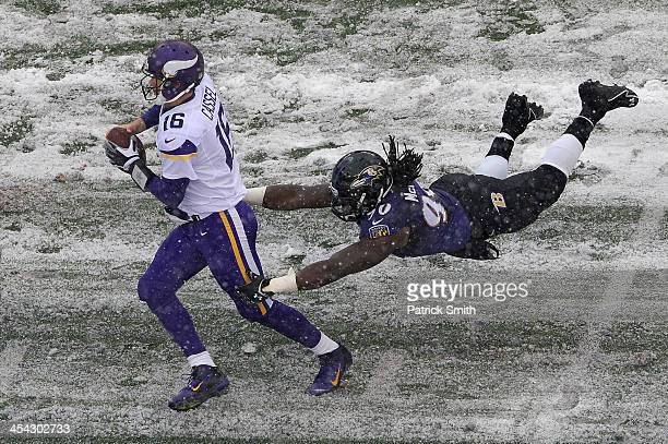Quarterback Matt Cassel of the Minnesota Vikings avoids being sacked by linebacker Pernell McPhee of the Baltimore Ravens in the second quarter at MT...