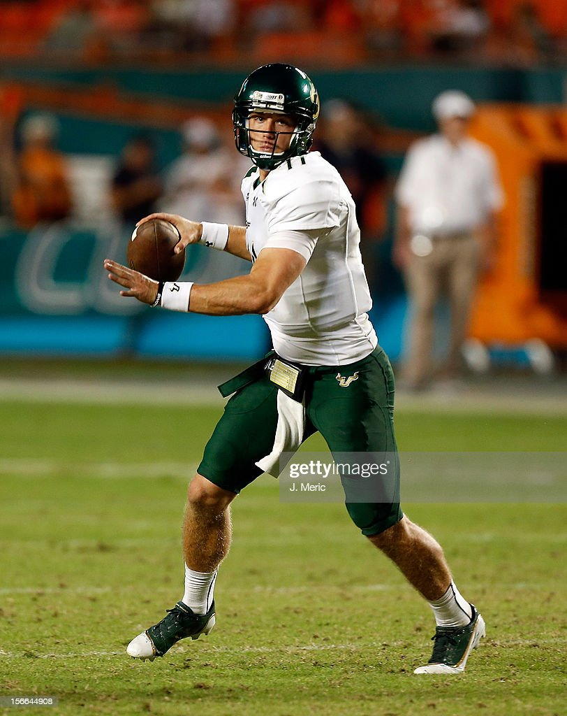 Quarterback Matt Floyd #11 of the South Florida Bulls rolls out against the Miami Hurricanes during the game at Sun Life Stadium on November 17, 2012 in Miami Gardens, Florida.