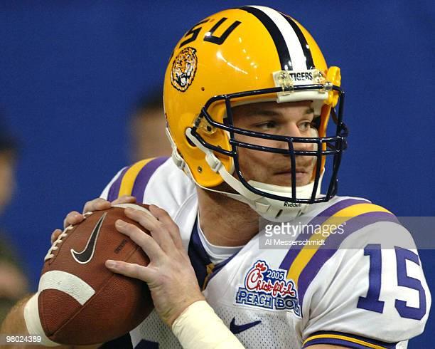 LSU quarterback Matt Flynn sets to pass against the University of Miami in the 2005 ChickfilA Peach Bowl at the Georgia Dome in Atlanta Georgia on...