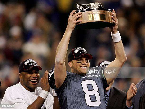 Quarterback Matt Hasselbeck joined by running back Shaun Alexander holds up the NFC Championship trophy following their team's victory over the...