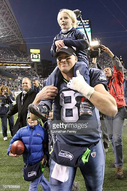 Quarterback Matt Hasselbeck of the Seattle Seahawks celebrates the Seahawks 4136 victory against the New Orleans Saints as his son Henry Hasselbeck...