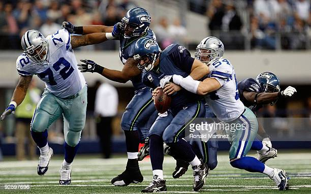 Quarterback Matt Hasselbeck of the Seattle Seahawks is sacked by Bobby Carpenter of the Dallas Cowboys at Cowboys Stadium on November 1 2009 in...