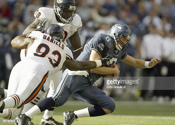 Quarterback Matt Hasselbeck of the Seattle Seahawks is tackled by Phillip Daniels of the Chicago Bears on October19, 2003 at Seahawks Stadium in...