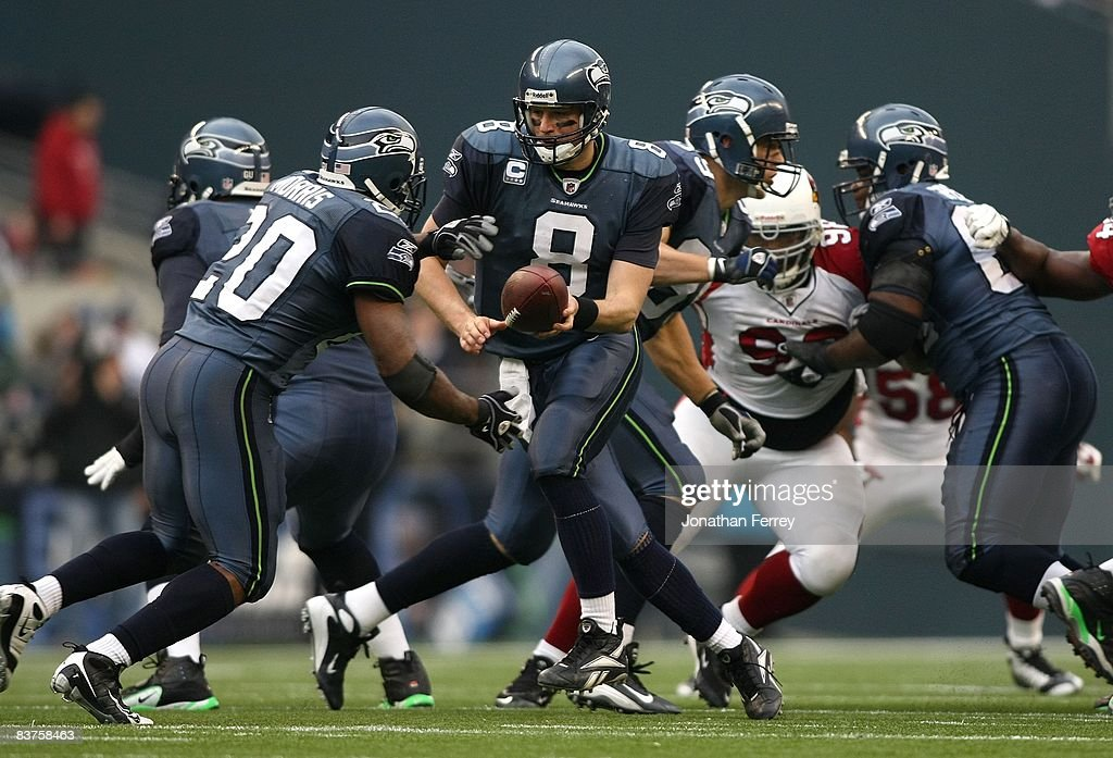a3c74d999 Quarterback Matt Hasselbeck of the Seattle Seahawks looks to hand ...