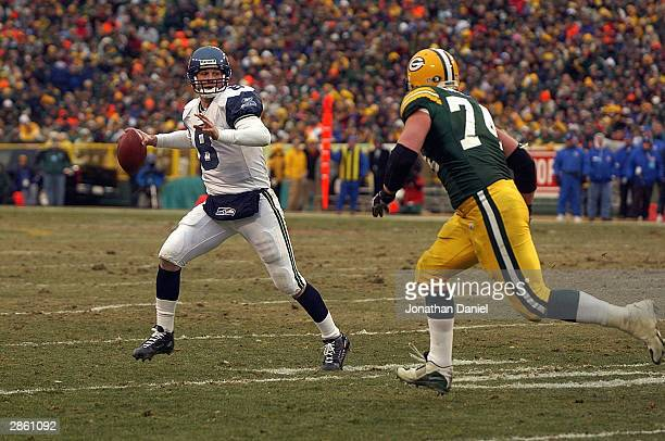 Quarterback Matt Hasselbeck of the Seattle Seahawks scrambles in the NFC Playoff game as Aaron Kampman of the Green Bay Packers tries to sack him on...