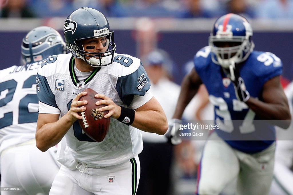 f222d0ff3 Quarterback Matt Hasselbeck of the Seattle Seahawks steps back to ...