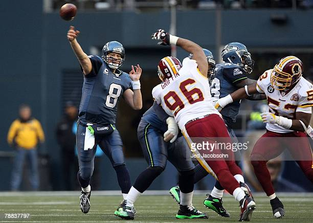 Quarterback Matt Hasselbeck of the Seattle Seahawks throws the ball against the Washington Redskins during the NFC Wild Card game at Qwest Field on...