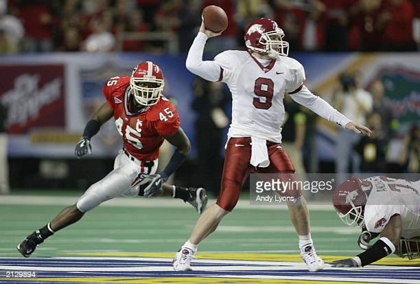 Quarterback Matt Jones of the University of Arkansas Razorbacks attempts to get a pass off before being sacked by strong side linebacker Boss Bailey...