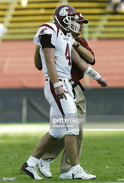 Quarterback Matt Kegel of the Washington State Cougars is helped off the field after injuring his shoulder against the Stanford Cardinal on October...
