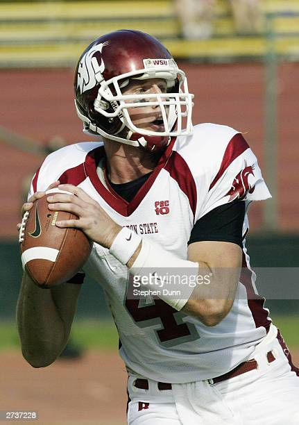 Quarterback Matt Kegel of the Washington State Cougars looks for an open receiver during the game against the Stanford Cardinal on October 18 2003 at...