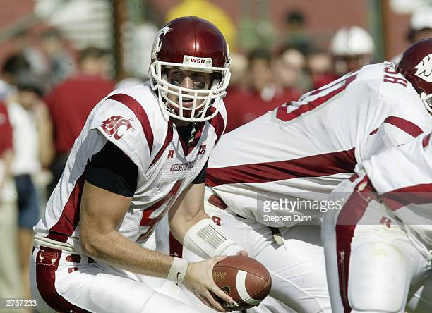 Quarterback Matt Kegel of the Washington State Cougars looks to hand off the ball during the game against the Stanford Cardinal on October 18 2003 at...