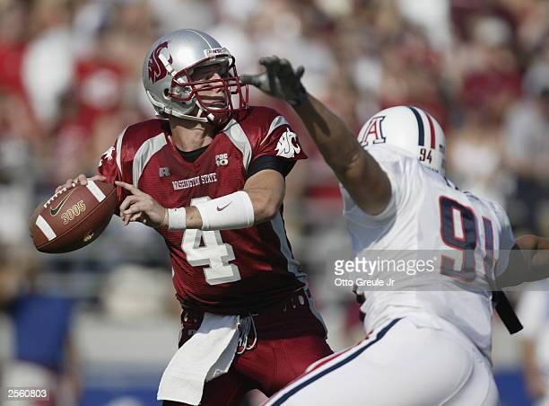 Quarterback Matt Kegel of the Washington State Cougars passes against Paul Philipp of the University of Arizona Wildcats on October3 2003 at Martin...
