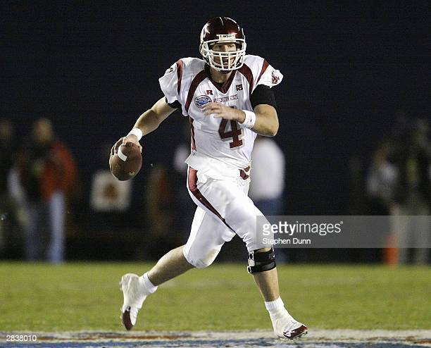 Quarterback Matt Kegel of the Washington State Cougars runs with the ball against the University of Texas Longhorns in the Pacific Life Holiday Bowl...