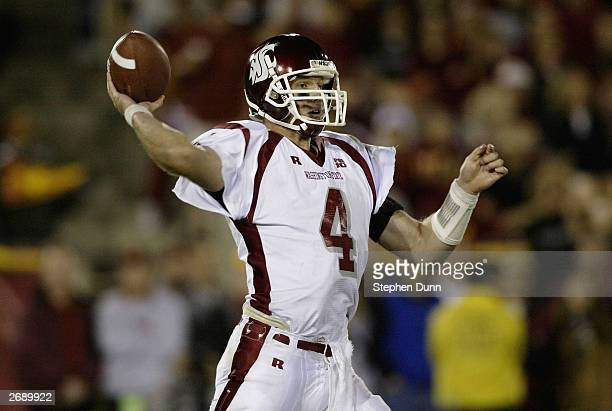 Quarterback Matt Kegel of the Washington State Cougars throws a pass against the USC Trojans November 1 2003 at the Los Angeles Coliseum in Los...