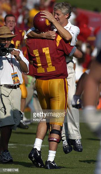 USC quarterback Matt Leinart and coach Pete Carroll celebrate 2317 victory over Cal at the Los Angeles Memorial Colsieum in Pac10 Conference football...