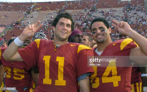 USC quarterback Matt Leinart and defensive tackle Shaun Cody celebrate 457 victory over Arizona State in Pacific10 Conference football game at the...