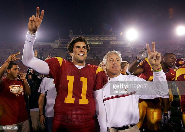 Quarterback Matt Leinart and head coach Pete Carroll of the USC Trojans celebrate following their 5121 victory over the Stanford Cardinal at the Los...