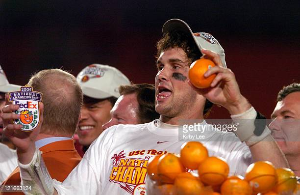 Quarterback Matt Leinart celebrates on the awards podium after 55-19 victory over Oklahoma in the FedEx Orange Bowl at Pro Player Stadium in Miami,...