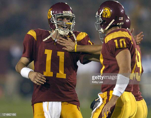USC quarterback Matt Leinart celebrates with Matt Cassell in the fourth quarter of 499 victory over Arizona in Pacific10 Conference football game at...