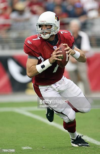 Quarterback Matt Leinart of the Arizona Cardinals moves to pass the ball during the game against the Seattle Seahawks at University of Phoenix...