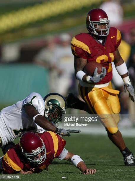 Quarterback Matt Leinart of the University of Southern California makes a crucial block for teammate LenDale White's run blocking safety Brandon...