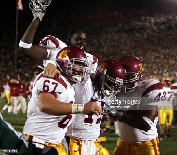 Quarterback Matt Leinart of the University of Southern California Trojans celebrates his winning touchdown against the Notre Dame Fighting Irish with...