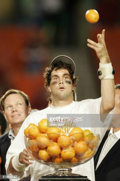 Quarterback Matt Leinart of the USC Trojans celebrates by throwing oranges after defeating the Oklahoma Sooners 5519 to win the FedEx Orange Bowl...