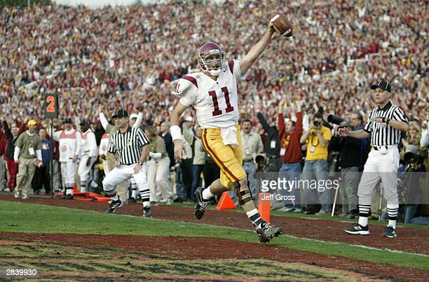 Quarterback Matt Leinart of the USC Trojans celebrates his touchdown reception against the Michigan Wolverines during the 2004 Rose Bowl on January 1...