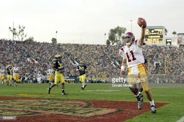 Quarterback Matt Leinart of the USC Trojans celebrates his touchdown catch against the Michigan Wolverines in the 2004 Rose Bowl on January 1 2004 at...