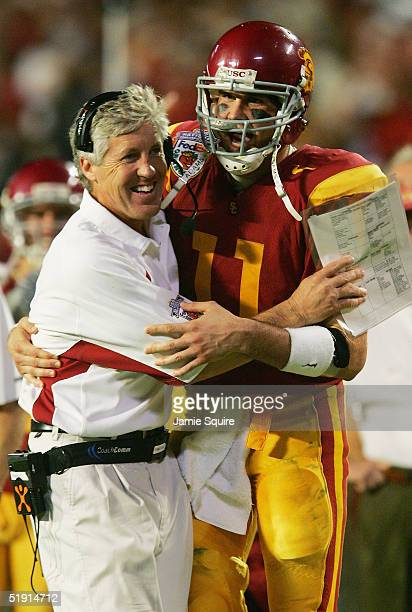 Quarterback Matt Leinart of the USC Trojans celebrates with head coach Pete Carroll in the fourth quarter against the Oklahoma Sooners during the...