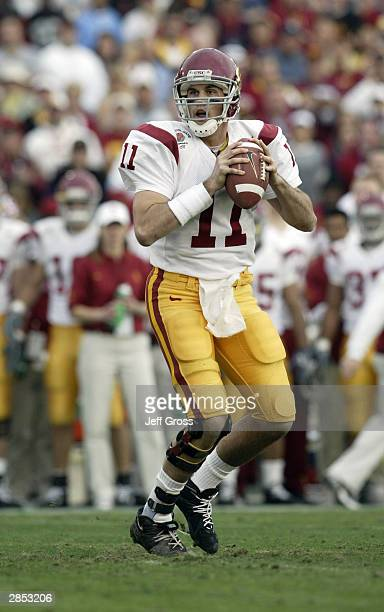 Quarterback Matt Leinart of the USC Trojans drops back to pass during the 2004 Rose Bowl game against the Michigan Wolverines on January 1 2004 at...